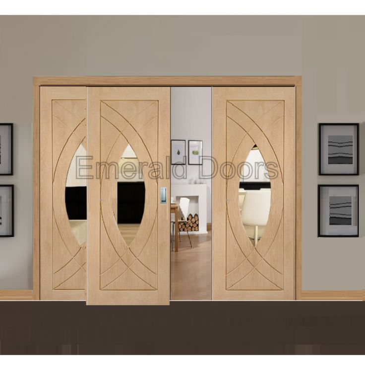 The Treviso three door sliding system, with two fixed panels and front sliding door system.  Dare to be different with this modern design. #emeralddoors #oak #diy #doors #interior #internaldoors