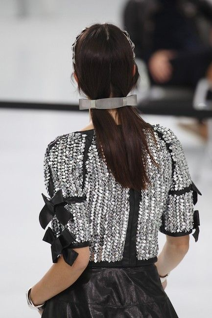 Models sported pigtails clasped by modern silver barrettes at Chanel's Spring 2016 show in Paris.