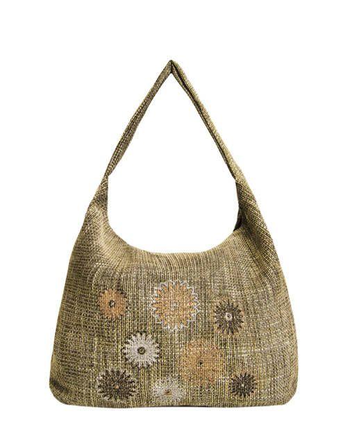 """Kabelka Vanda """"Jeseň-Zima 2015"""" Táto kabelka je z textilného materiálu. Je to taká sivo-béžovo-hnedo-strieborná farba. Na prednej strane je jedinečná výšivka v rôznych farbách. Zadná strana je bez výšivky. Kovanie je staronikel. Je to veľká taška s množstvom priestoru vo vnútri. Strih je ležérny, jednoduchý. Je to veľmi obľúbený model. Vo vnútri je jedno vrecko na ..."""