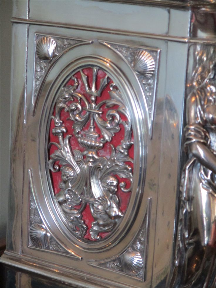 Silver mantle clock by Lund & Brockley, London. Designed by A. Crichton. Detail of side casing.