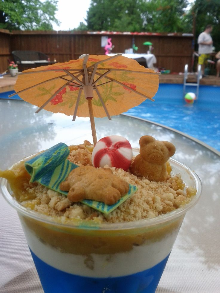 Sand Cups: Beach or Pool Party Treats~ fun for  kids to make during summer & eat by the pool- jello, vanilla pudding, cool whip & crushed vanilla wafers, top with teddy grams & umbrella