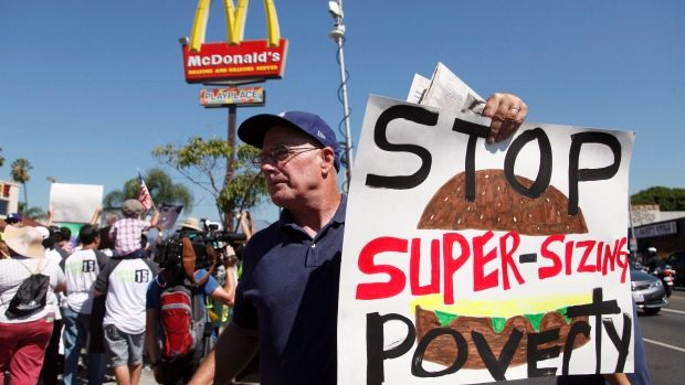 Meaningful slogans in numerous protests for fast-food wage in the U.S. (U.S. fast food workers cost $7B a year in public benefits)