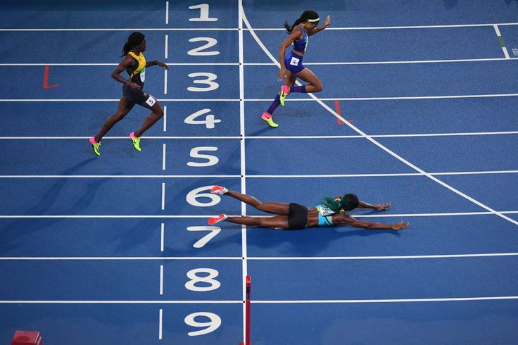 Shaunae Miller, bottom, wins the women's 400-meter final against Allyson Felix after diving across the finish line. - Best images from Aug. 15 at the Rio Olympics: 2016