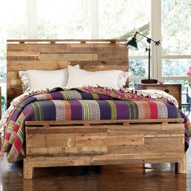 Wood boards salvaged from rugged shipping pallets are repurposed by sleek design into a rustic patchwork at home in urban loft or country cottage.