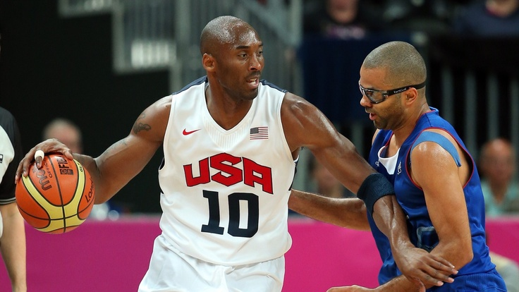 Kobe Bryant of the United States drives against Tony Parker of France during their men's Basketball Game on Day 2 of the London 2012 Olympic Games at the Basketball Arena.