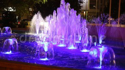 Fountain illuminated in blue decorative in the night.