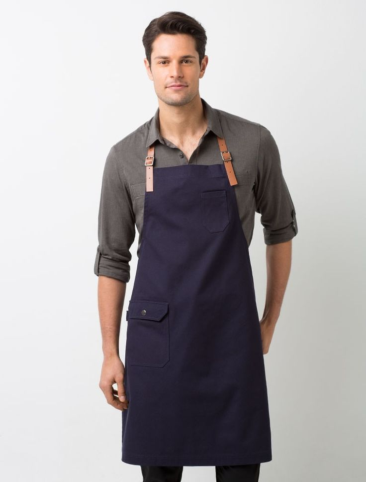 The Otto Bib Apron in Marine is a standout in both design and style, leading the way in fashionable modern uniforms. The adjustable genuine leather neck-strap adds authentic detail making it the perfect designer apron of choice. With its added design features including a utility style hip pocket, gunmetal grey buckles and functional tea towel loop, the Otto is the perfect staff uniform addition to any hospitality event or work place. Also available in heavyweight Sulphur or Bluestone, or as…