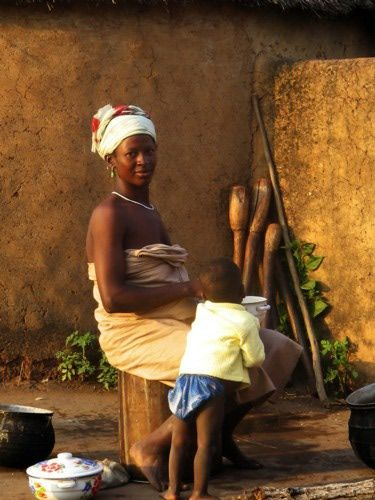 A woman and her child enjoying morning porridge in Nabila Village, Northern Ghana.