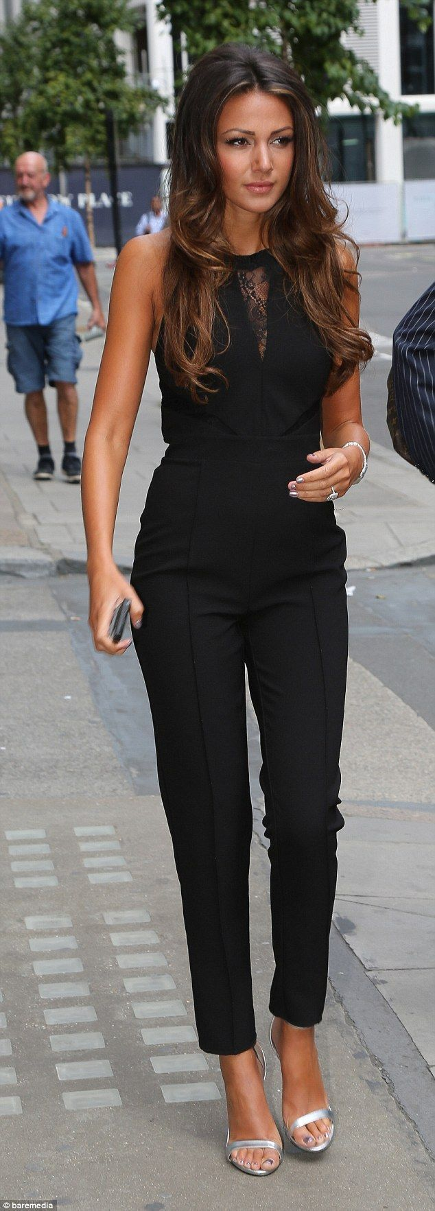 Michelle Keegan.. Michelle Keegan for Lipsy black jumpsuit with lace panels, and Zara silver strappy sandals..