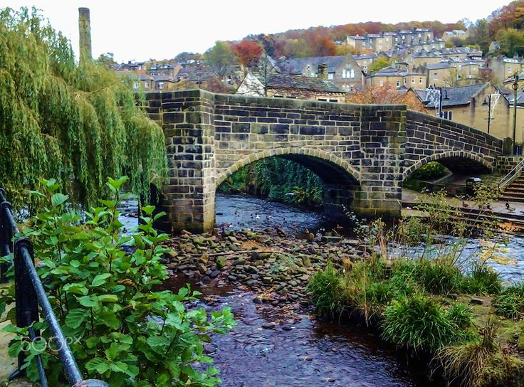 Packhorse Bridge at Hebden Bridge. - The old packhorse bridge over Hebden Water can be seen in the centre of the small West Yorkshire town of Hebden Bridge,