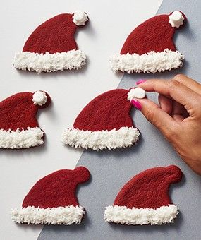 Red Velvet Santa Hat cookies! So simple and yet so adorable!! Santa Cookies! 15 Santa Claus Cookies Your Kids Will Love