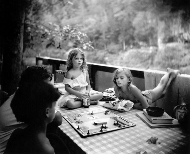 Sally Mann/this is how we spent alot of time as kids, playing board games.