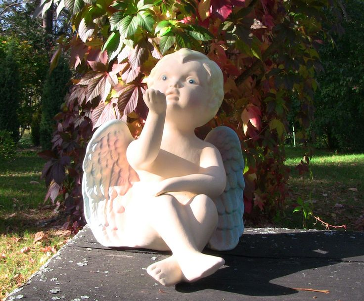 Ceramic painted angel. Cute element of decor for inside and outside uses.