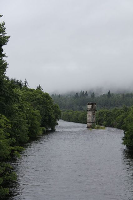 The River Oich that runs through Fort Augustus into Loch Ness and Old Railway Viaduct Columns Fort Augustus Inverness - Shire, Scotland