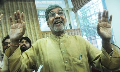 Kailash Satyarthi reacts as he talks to the media on Friday at his office in Delhi after winning the Nobel peace prize.