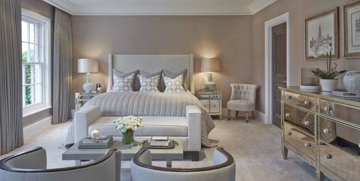 Neutral master bedroom decor ideas. End of the bed upholstered bench. Ivory and grayish blue. Soft luminous bedroom palette.