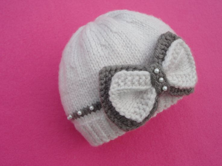 Baby hat with bow...I have no idea how to knit but this is so cute, bet I could figure out how to have the same look with crochet