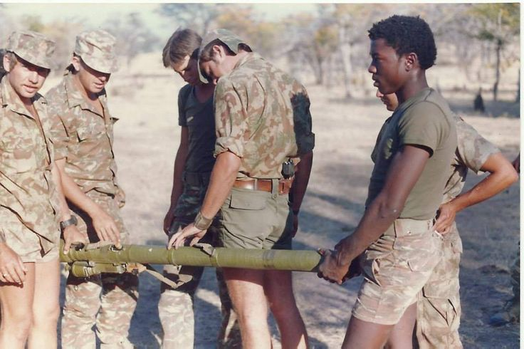 """Koevoet (literally """"crowbar"""") paramilitaries inspect a captured  9K32 Strela-2, better known to the West as the SA-7 """"Grail"""" surface-to-air missile launcher."""