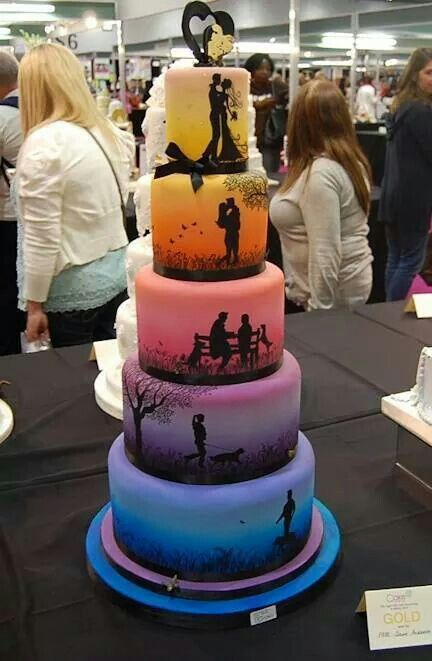 Beautiful Wedding Cake. I'm sure its done with fondont, which tastes nasty! The idea is beautiful.