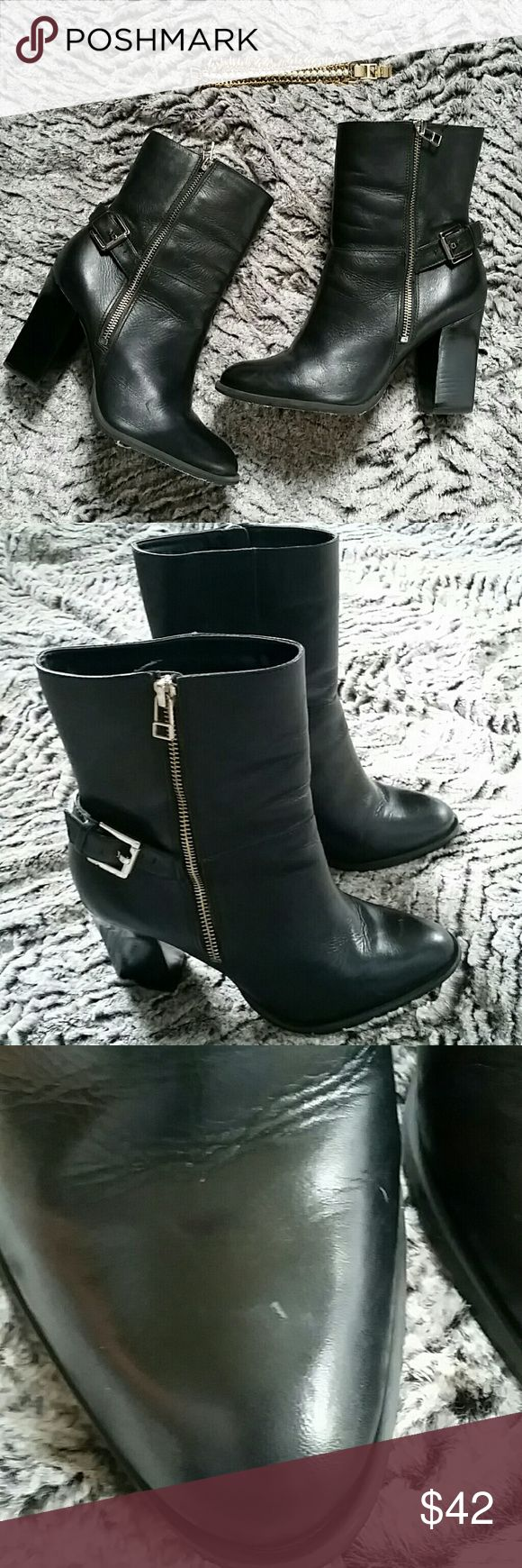 Shoestock Brazil Boots Stunning black leather boots with chunky heels. Zips up the outer ankle.  Buckle embellishment.  Small scuff on right toe (pic 3) but otherwise excellent condition.  Bottoms were treated with a protective layer which is starting to peel.  Heel height is 3.25 inches.  Boot height is 9.5 inches. Shoestock Shoes Heeled Boots
