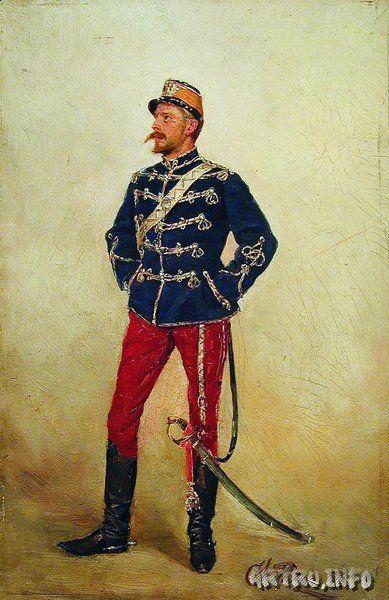 Молодой мужчина в военной форме.