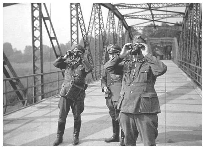 German officers watch as Poland occupies the Czech town of Bohumin. Following the Munich Agreement, Bohumín and the Zaolzie region were annexed by Poland in October 1938.