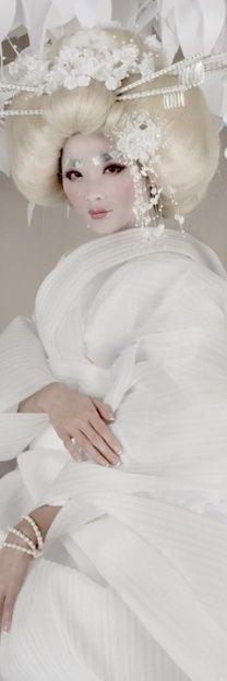 Beautiful Geisha in white.