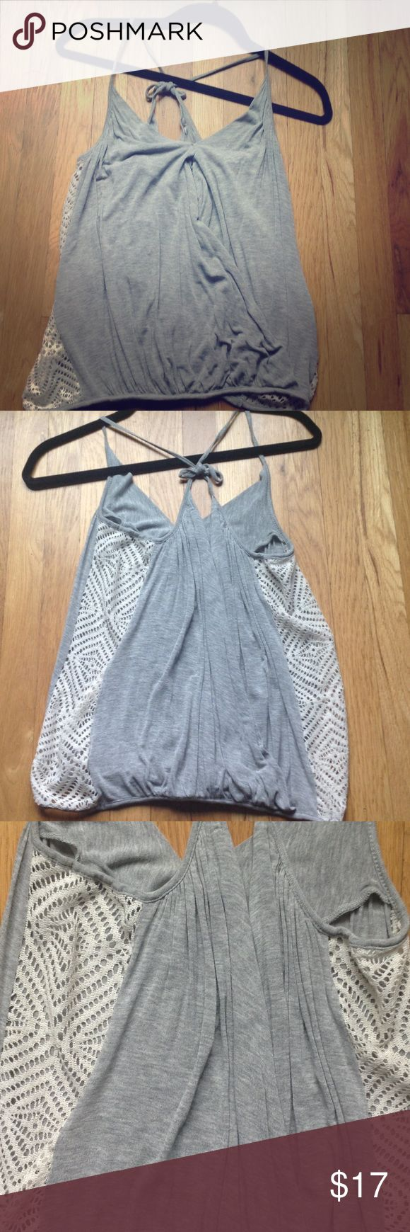 FREE PEOPLE GREY CAMI TOP Lovely Free People grey Cami top. It has a beautiful side detail that looks mesh and can be worn very beautifully with shorts or jeans Free People Tops Camisoles