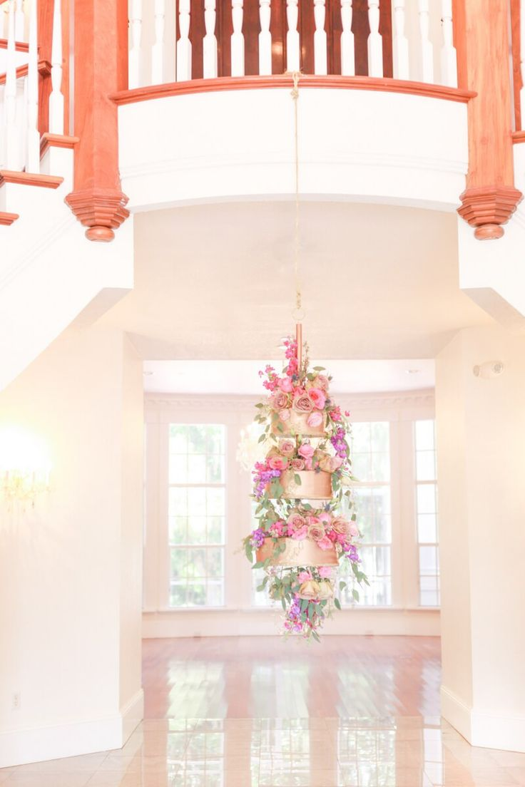 hanging cake from a berry hued wedding inspiration