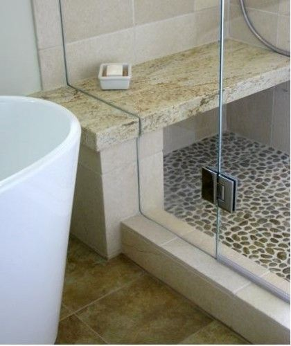 River rock creates a beautiful floor for a shower in for River rock bathroom ideas