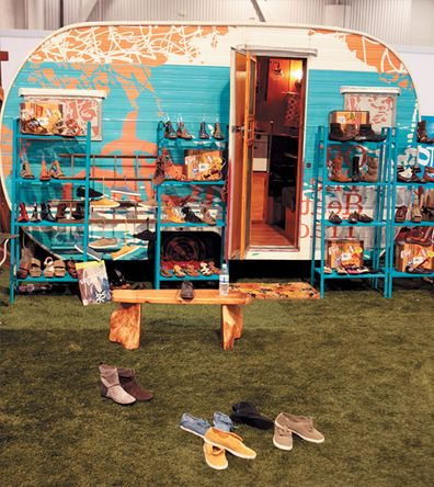 Trade Show Inspiration: Off the Beaten Track.  The booth itself resembles a campsite. And the vintage RV houses the collection.