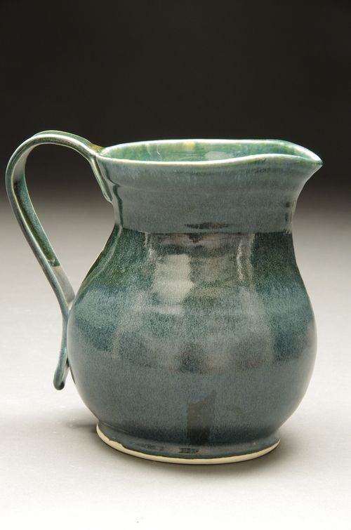 Wide bellied jug with a curved handle. White stoneware fired to cone 6  Available for purchase