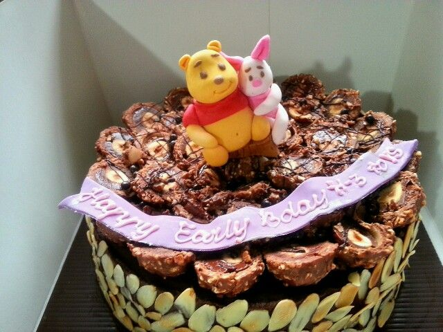 Winnie the pooh and piglet on ferrero roche cake