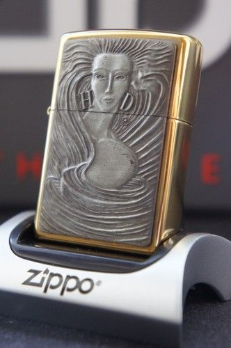 ZIPPO LIGHTER 24Ct GOLD PLATED HARLEY DAVIDSON GOLDEN GIRL WITH EARRINGS RARE & UNUSUAL ZIPPO LIGHTERS, CASES, AND ACCESSORIES FROM easyonthewedge2011