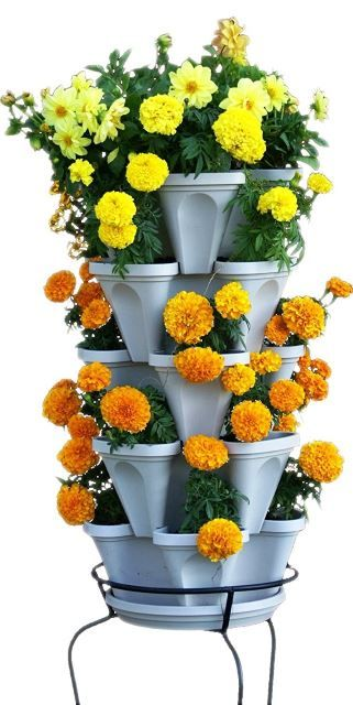 This creative vertical tiered planter is a perfect way to keep all your plants watered and healthy with minimal work. Since the system is dripping downward, all the plants will become saturated with water at the bottom., It's a perfect way of leaving the guesswork out when to water which plants. This is also a really cute design that will look great in a kitchen or dining nook area.