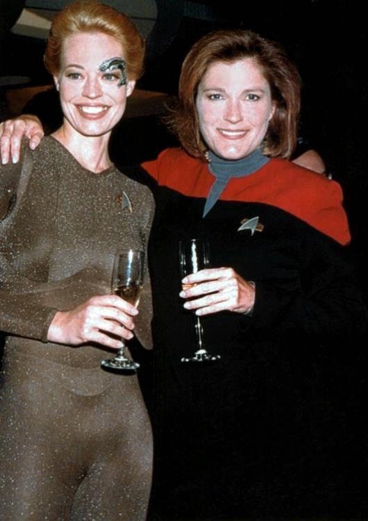 "Jeri Ryan (Seven of Nine) and Kate Mulgrew (Janeway) toast Star Trek Voyager's 100th episode, ""Timeless"" in 1998"