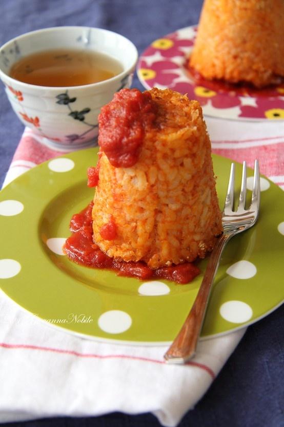 Mini sartù di riso con mozzarella, salsiccia e funghi secchi