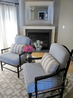 Casual chic: Beach house chairs get a low-brow lift using inexpensive mattress ticking for covers.  So pretty!