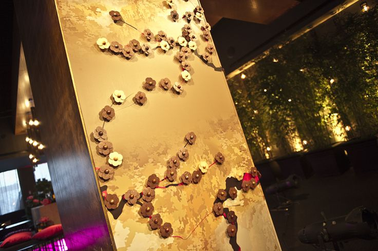 Theme from JAK's Neo Oriental Launch Party.  Spectacular chocolate wall installation.  Panels for the installation designed by Theme from JAK. Delectable chocolate blossoms by Sisko Chocolate. #themefromjak #siskochocolate