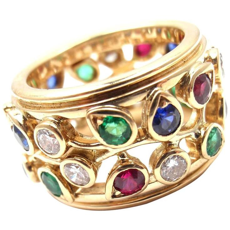 Cartier Diamond Sapphire Emerald Ruby Wide Yellow Gold Band Ring   From a unique collection of vintage band rings at https://www.1stdibs.com/jewelry/rings/band-rings/