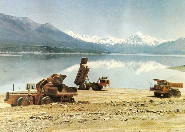 In one of the nicest vistas you are ever likely to see, three of Baker Constructions International PayHaulers, two 340's and a 350 pose beside Lake Pukaki. They are being loaded by an International 560 PayLoader
