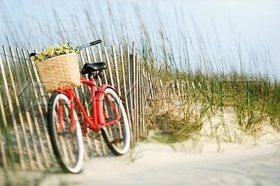 a bike on a beach <3