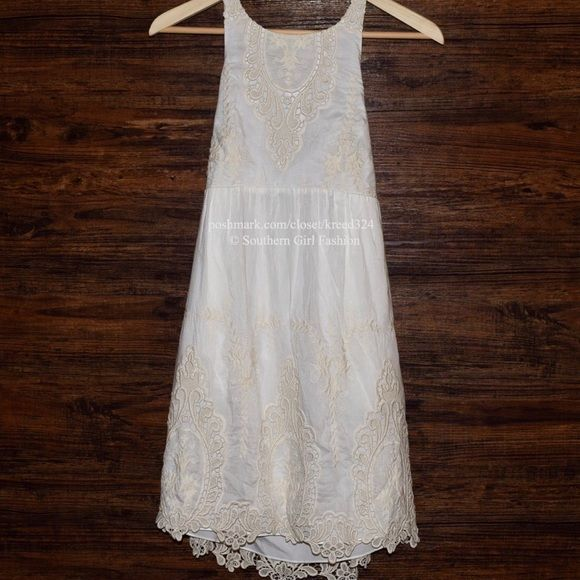 DOLCE VITA Lace Dress Nude Embroidered Eyelet Mini Size Small. New With Tags. $242 Retail + Tax.  • Beautiful & sophisticated, this classic halter dress features intricate eyelet petticoat embroidery & banded, elastic back.  • Halter-style neck with speckled button.  • Hidden side zip closure & slip pockets at hips. • Self lined, cotton silk blend.  • Measurements provided in comment(s) section below  {Southern Girl Fashion - Closet Policy}   ✔️ Same-Business-Day Shipping (10am CT). ✔️ Price…