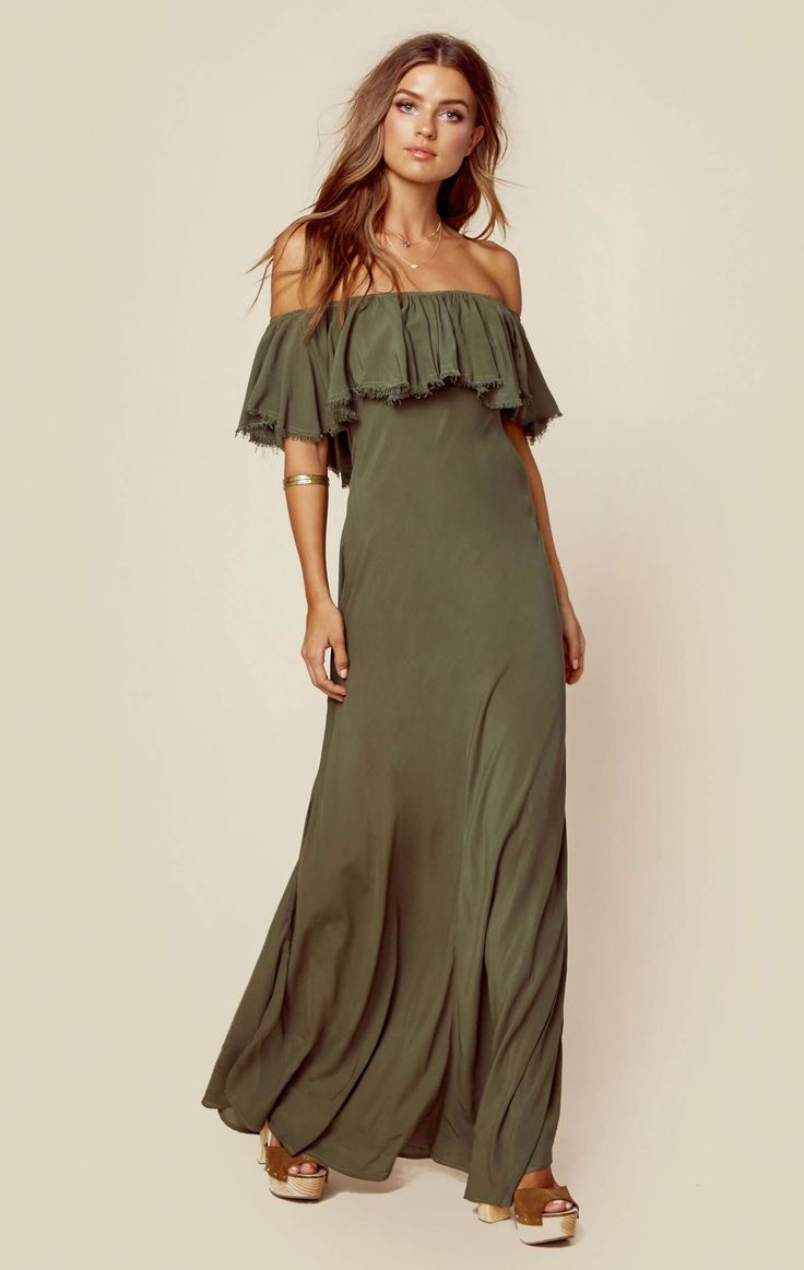 """This pretty and romantic dress by Blue Life features an off the shoulder neckline with ruffled bodice and a full length skirt.  Made in USADry Clean Only100% RayonFit Guide:Model is 5ft 7 inches; Bust: 34"""", Waist: 25"""", Hips: 35""""Model is wearing a size XSRelaxed FitShoes Featured Not Available For Purchase"""