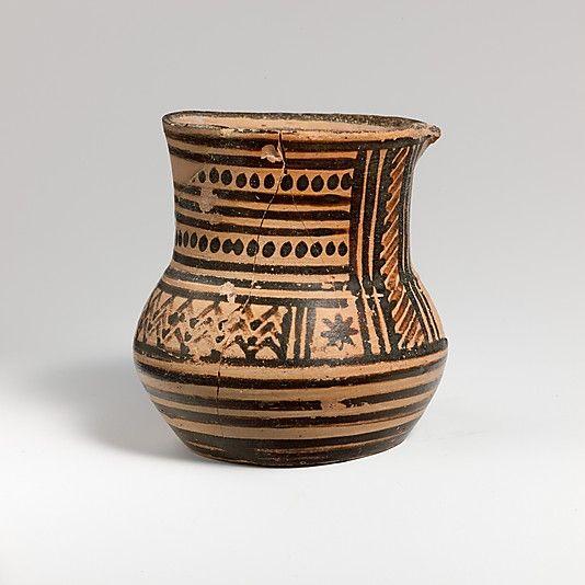 Terracotta tankard    Period:      Geometric  Date:      late 9th century B.C.  Culture:      Greek, Attic  Medium:      Terracotta  Dimensions:      H. 2 3/4 in. (6.9 cm)  Classification:      Vases