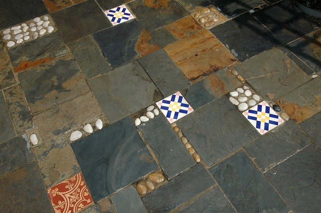 Great paving idea for patio, tiles and pebbles from beach