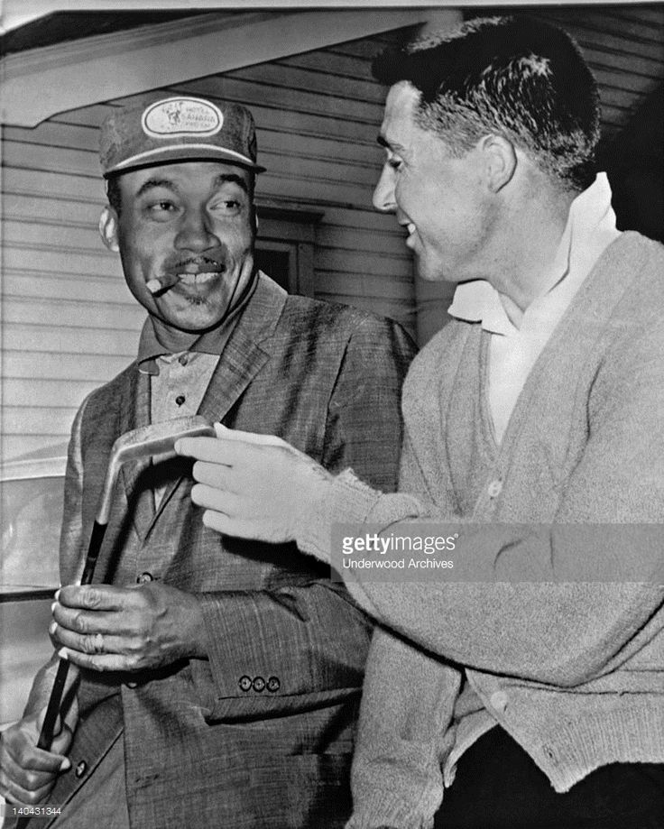 Charley Stifford, left, the only Negro in the National Open Golf Championship tournament which starts tomorrow at the Oakmont Country Club, chats with Gary Player of South Africa, Oakmont, Pennsylvania June 13, 1962. Stifford helped to desegregate the PGA of America, and was the first African American inducted into the World Golf Hall of Fame. He chose Gary Player to present him for the induction.