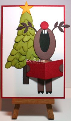 cute reindeer and tree out of punches.