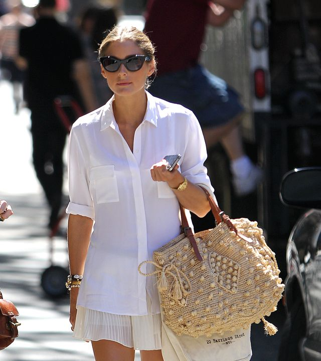 Olivia Palermo looks happy and very fashionable in NYC with a crisp, white button down shirt and silk pleated shorts / skirt / skort? in light, neutral colors #summer #spring
