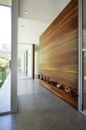 A glazed corridor lined with brush box connects a multipurpose room to the house.